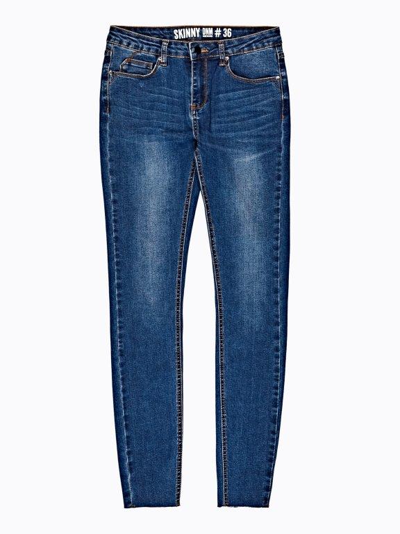 Skinny jeans with raw edge hem