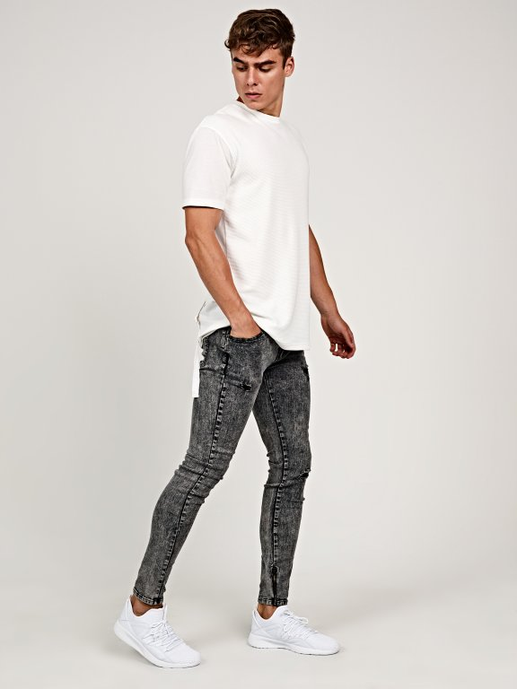 Damaged slim cropped fit jeans in snow wash