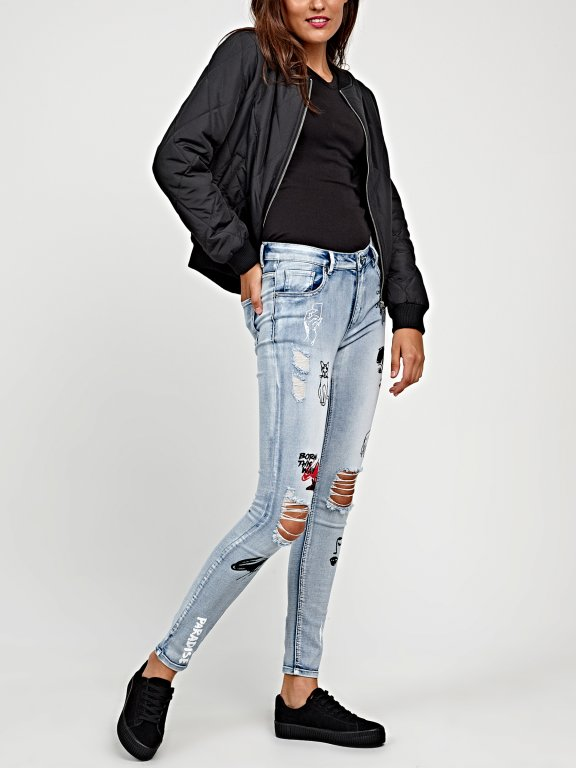 Damaged skinny jeans with prints