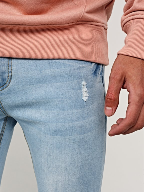 Distressed slim cropped fit jeans in light blue wash