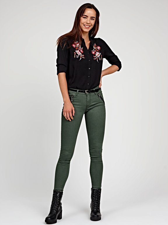 Stretch skinny trousers with zippers