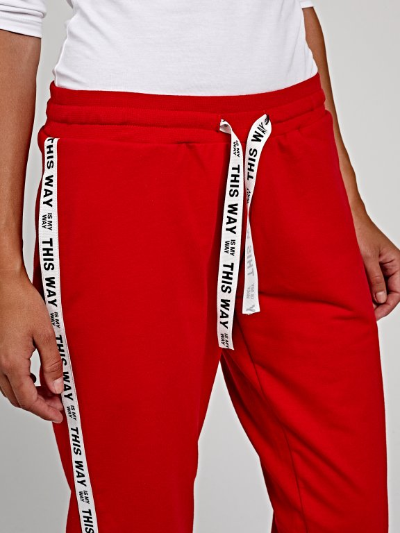 Sweatpants with printed tape
