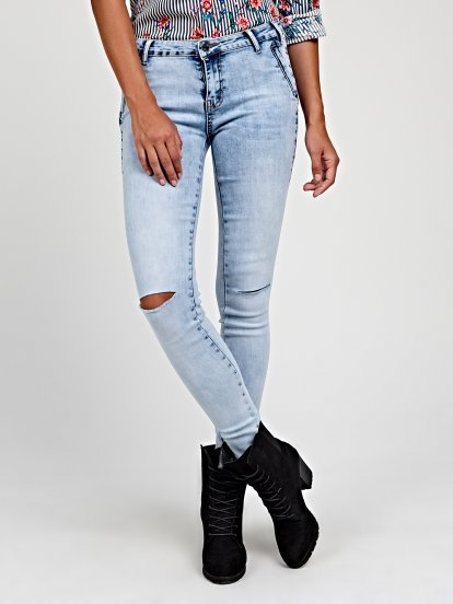 Ripped knee skinny jeans with zipper pockets
