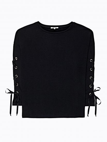 Top with sleeve lacing