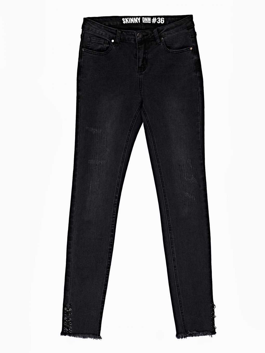 SKINNY JEANS WITH METAL RINGS ON HEM