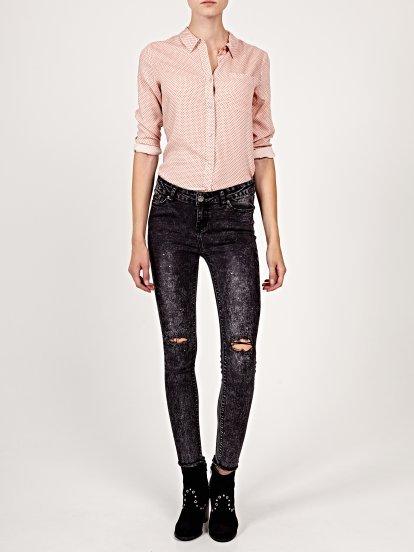 Damaged skinny jeans with splatter details