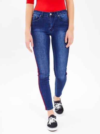 Taped skinny jeans in dark blue wash