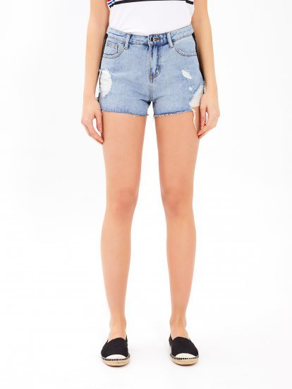Damaged taped denim shorts