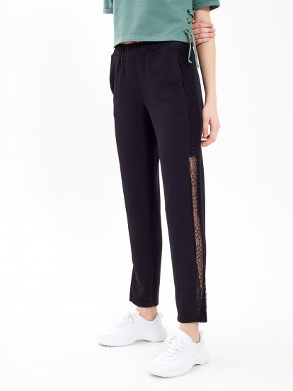 Trousers with lace panel