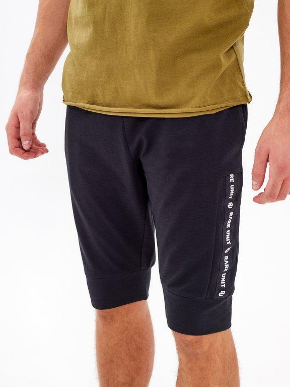 Teplákové šortky s bočním proužkem