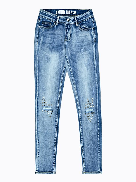 Distressed skinny jeans with studs
