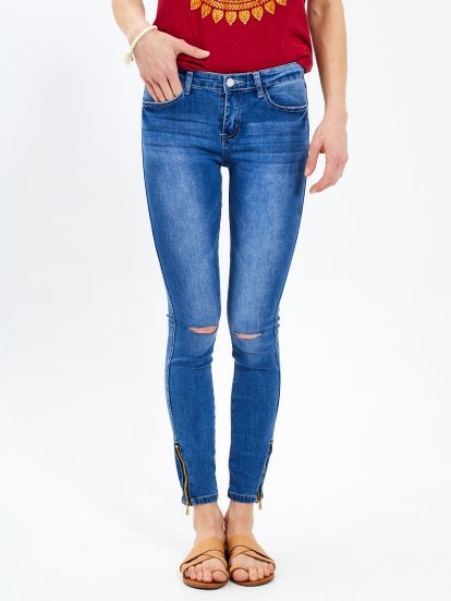 Ripped knees skinny jeans