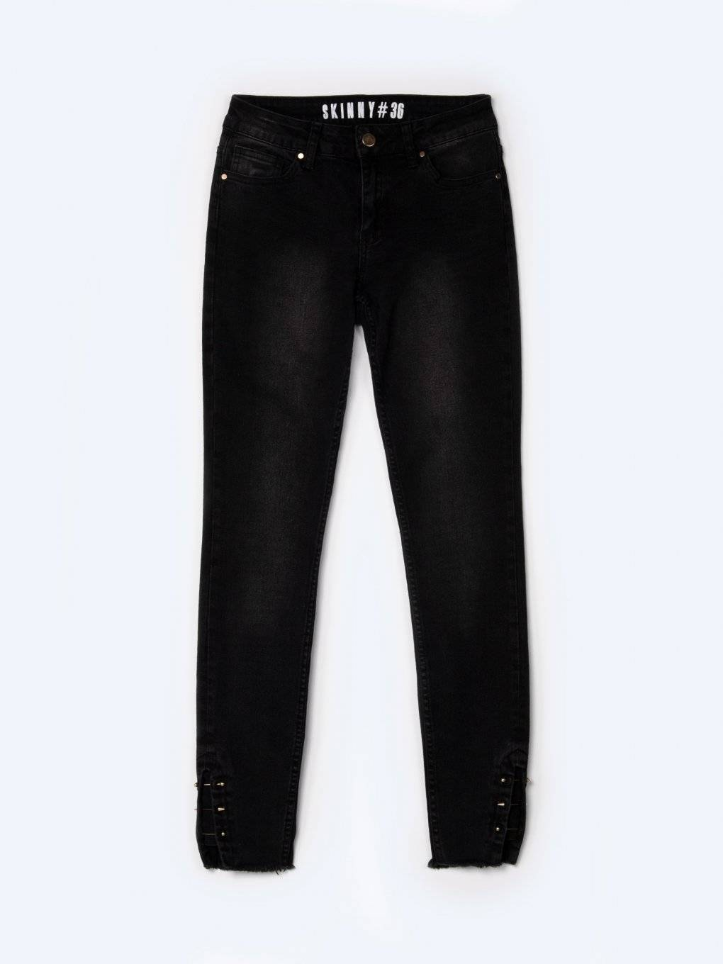 Skinny jeans with metal decoration on hem