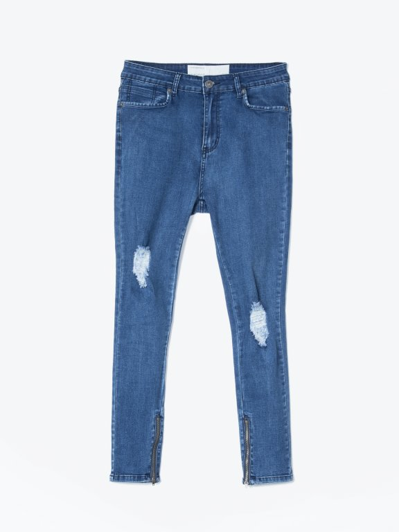Damaged slim fit cropped jeans with zippers