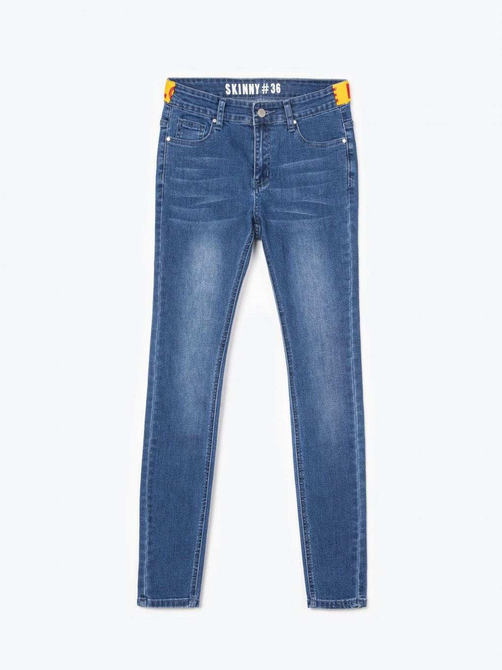 Skinny jeans with decorative tape on waist