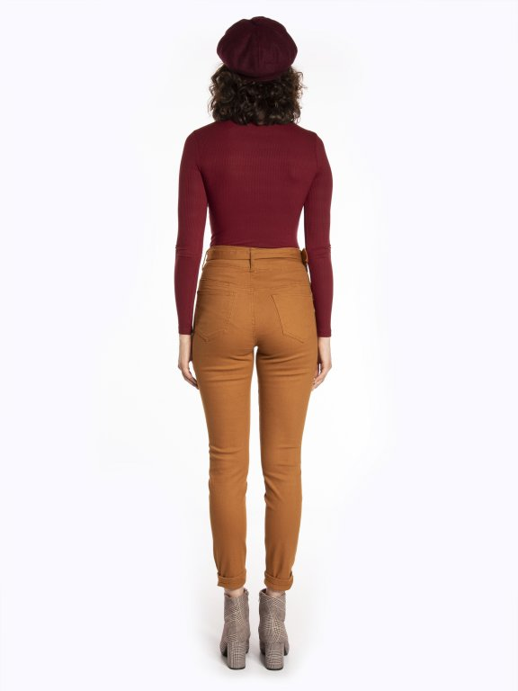 High waisted skinny jeans with a belt