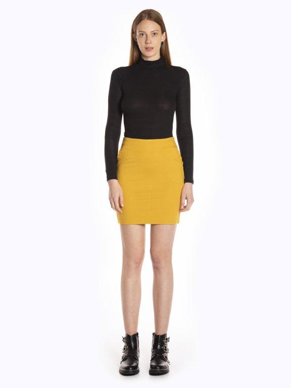 Bodycon mini skirt with ruffles on pockets