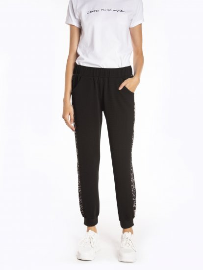 Stretchy jogger trousers with animal print side tape
