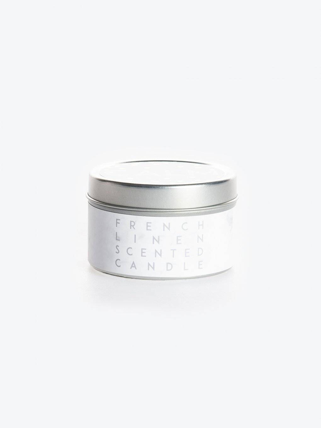 Orange blossom scented candle in a tin