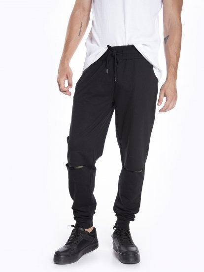 Distressed sweatpants with camo print patches