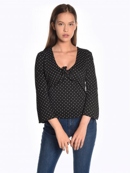 Polka dot print top with knot and bell sleeves