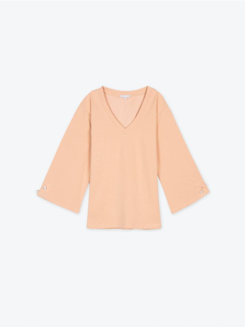 Oversized v-neck top with perls
