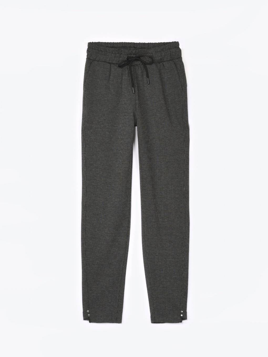 Striped sweatpants with metal rivets on ham