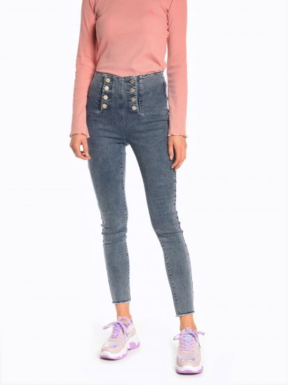 High waisted skinny jeans with decorative buttons
