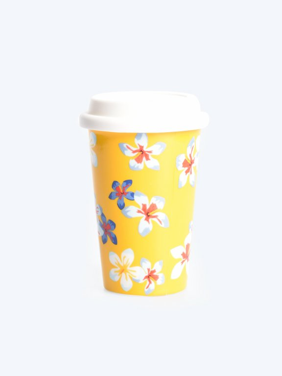 Travel mug with floral design