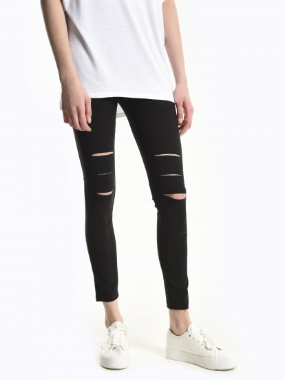 Stretch slim fit trousers with damages