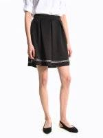 Skater skirt with decorative tape