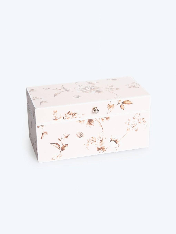 Wooden casket with flower design