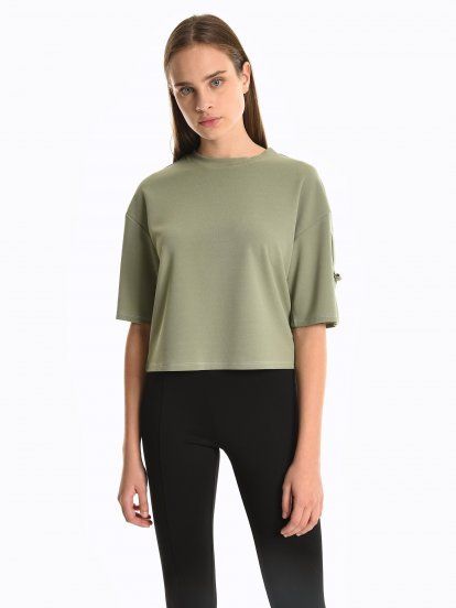 Top with decorative sleeve buckles