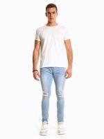 Damaged slim fit jeans