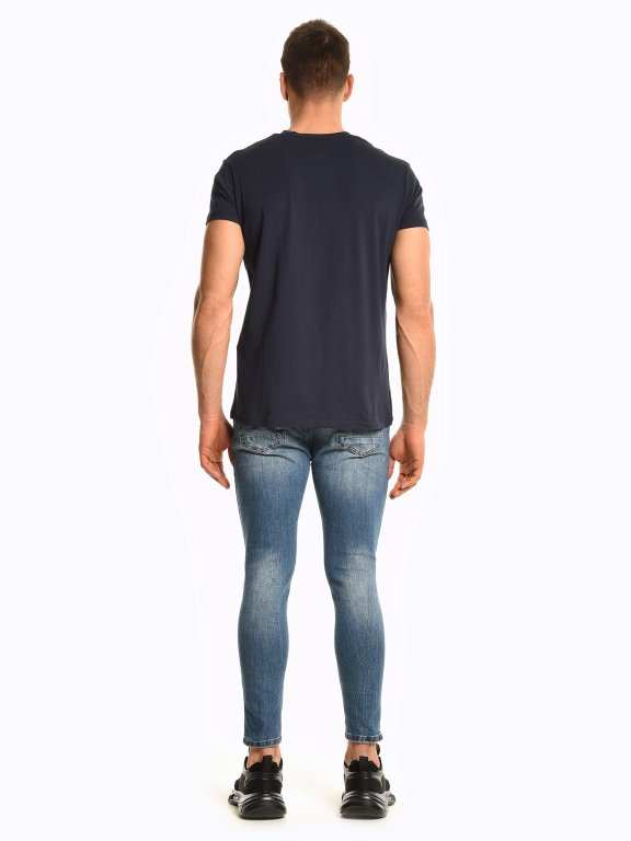 Tapered fit damaged jeans