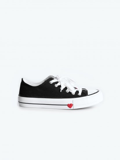 Lace up sneakers with heart detail on outsole