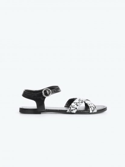 Flat sandals with animal pattern
