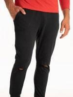 Ripped knee sweatpants