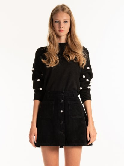 OVERSIZED JUMPER WITH POM POMS