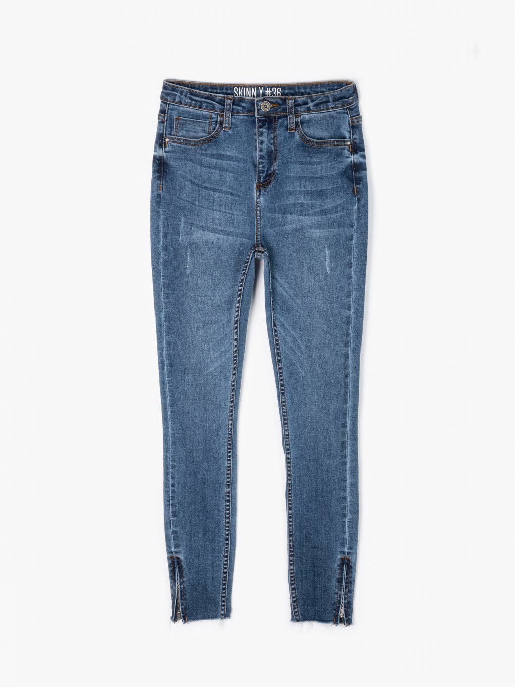 Skinny jeans with zippers on hems