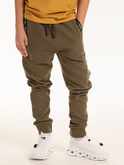 Sweatpants with taped pockets