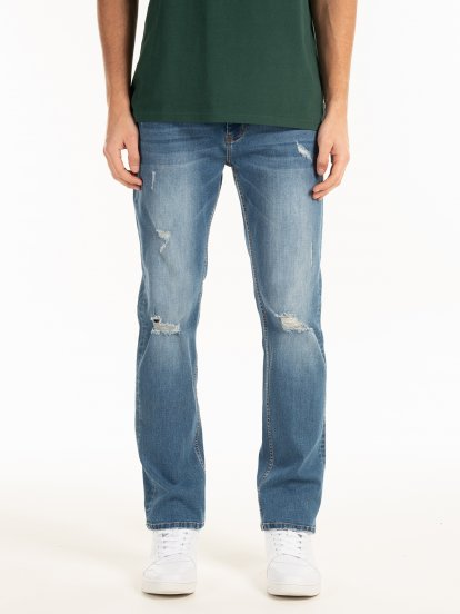 Regularne  jeansy z przetarciami