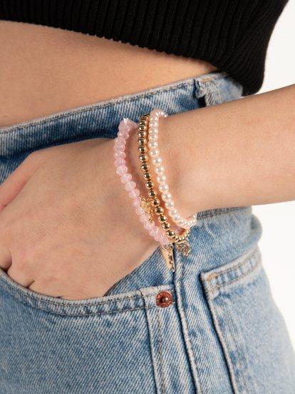3 bracelets with butterfly pendants
