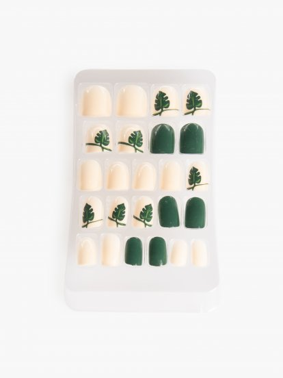 White artificial nails with monstera design