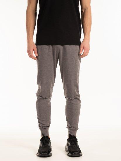Spodnie dresowe z dziurami