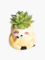 Faux flower in sloth flowerpot