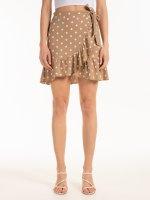 Zavinovacia bodkovaná mini sukňa