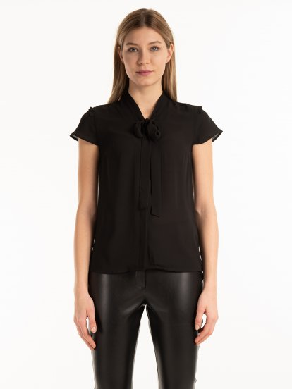 Blouse with bow tie
