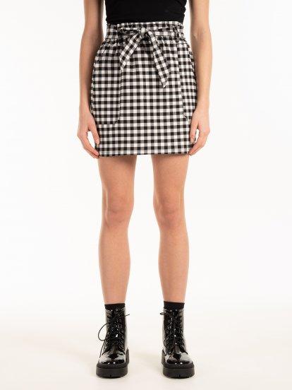 Kostkovaná pytlovité sukně