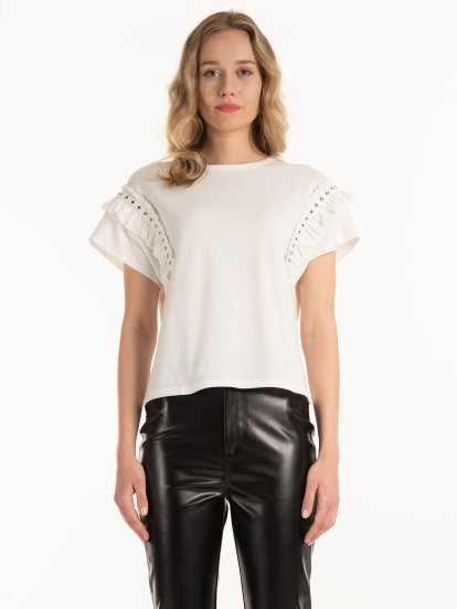 Top with ruffles and studs